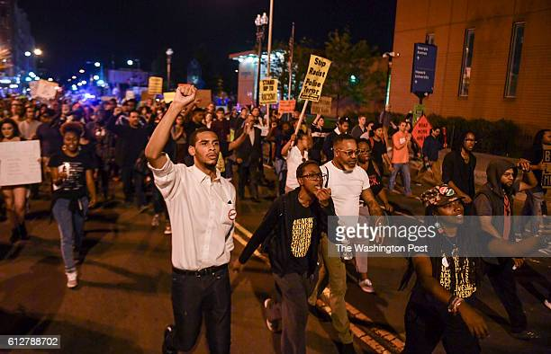 Protesters march down 7th Street NW following a candlelight vigil and rally for Terrence Sterling on October 3 2016 in Washington DC Sterling of Ft...