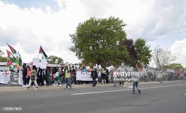 Protesters march down Central Ave SE during a demonstration in support of Palestinians on the 73rd Nakba Day in response to violence in Jerusalem and...