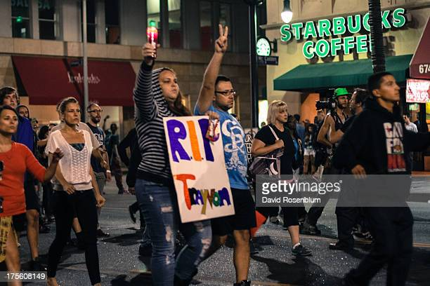 Protesters march down Hollywood Boulevard in Los Angeles to demonstrate against the not guilty verdict of George Zimmerman in the Trayvon Martin...