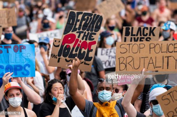 Protesters march down Pennsylavania Avenue from the Capitol as George Floyd police brutality demonstrations and marches are held around Washington on...