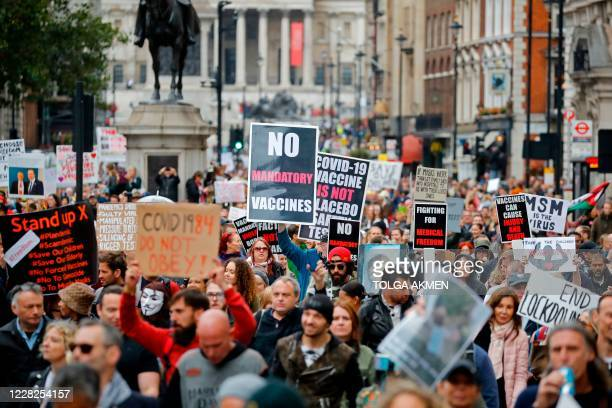 """Protesters march down Whitehall in central London to """"expose the truth about Covid and lockdown"""" at a demonstration organised by Save our Rights on..."""
