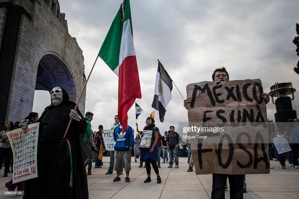 Protesters march during a demonstration against Mexico's government who suggests that 43 missing students were murdered and their charred remains tipped in a rubbish dump and a river in Guerrero, Mexico, on November 16, 2014 in Mexico City, Mexico.