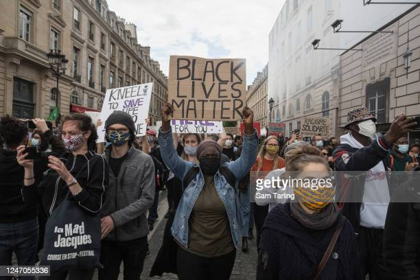 Protesters march during a demonstration against racism and police brutality in Place de La Concorde near the US embassy on June 6, 2020 in Paris,...