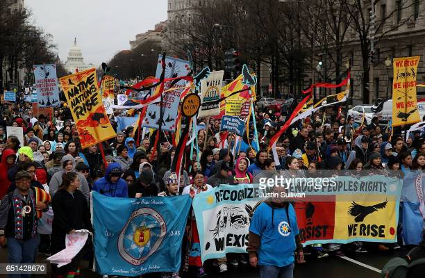 Protesters march during a demonstration against the Dakota Access Pipeline on March 10 2017 in Washington DC Thousands of protesters and members of...