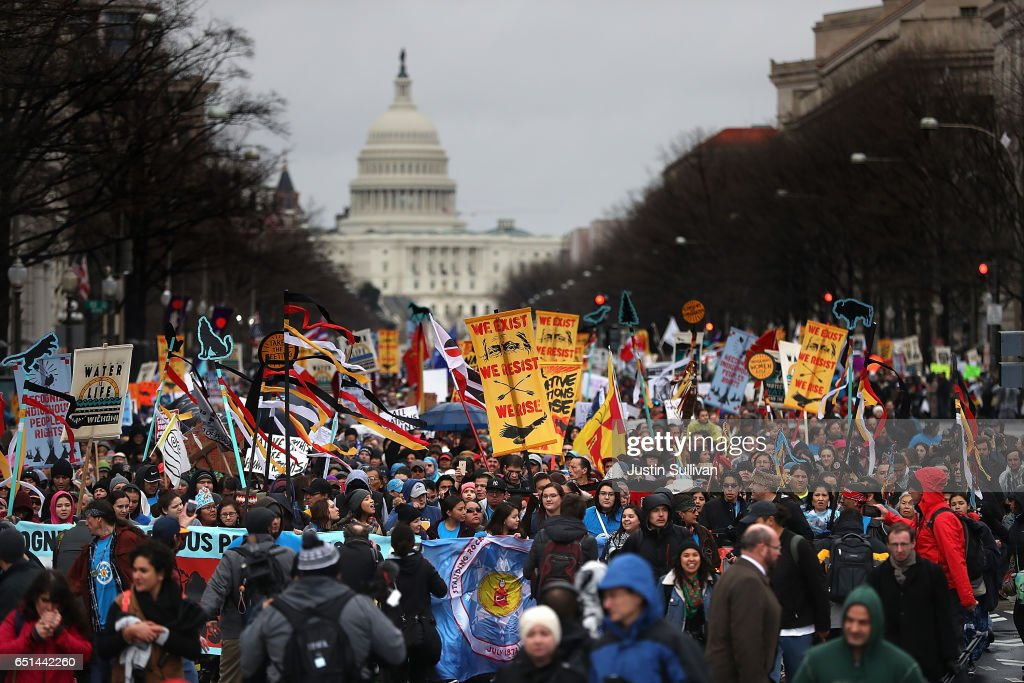 Protesters march during a demonstration against the Dakota Access Pipeline on March 10, 2017 in Washington, DC. Thousands of protesters and members of Native nations marched in Washington DC to oppose the construction of the proposed 1,172 Dakota Access Pipeline that runs within a half-mile of the Standing Rock Sioux reservation in North Dakota.