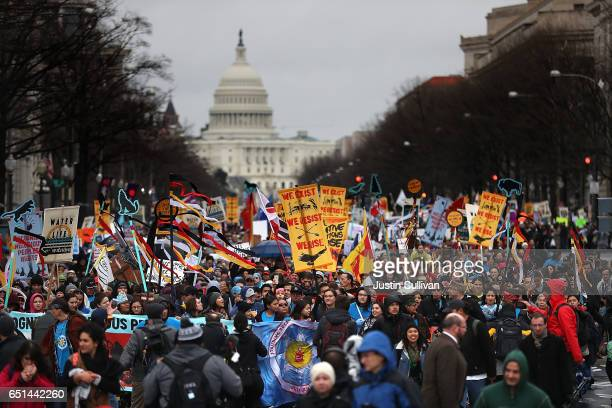 Protesters march during a demonstration against the Dakota Access Pipeline on March 10, 2017 in Washington, DC. Thousands of protesters and members...