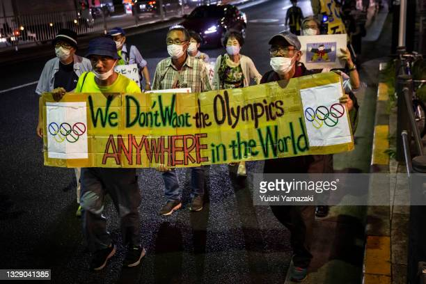 Protesters march during a demonstration against the forthcoming Tokyo Olympic Games on July 16, 2021 in Tokyo, Japan. Protesters gathered to...