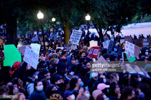 Protesters march during a demonstration over the death of George Floyd an unarmed black man who died in Minneapolis Police custody in Boston...
