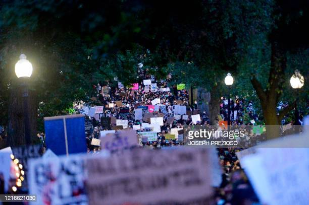 TOPSHOT Protesters march during a demonstration over the death of George Floyd an unarmed black man who died in Minneapolis Police custody in Boston...