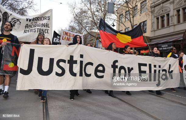 Protesters march during a demonstration staged to demand justice for the death of 14yearsold Indigenous teenager Elijah Doughty in Melbourne...