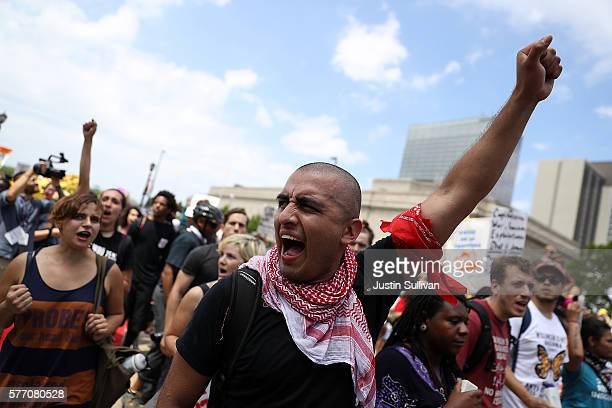 Protesters march during a Dump Trump demonstration near the site of the Republican National Convention on July 18 2016 in Cleveland Ohio Protestors...