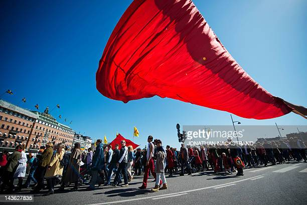 Protesters march during a May Day rally in central Stockholm on May 1 2012 Tens of thousands took to the streets across the globe for May Day to...