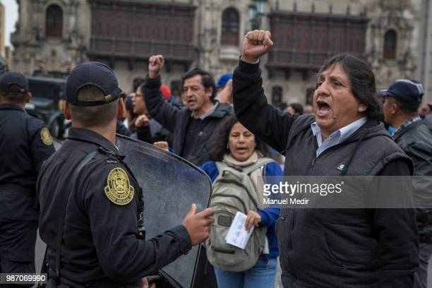 Protesters march during a protest against corruption in public institutions in front of Government Palace on June 27 2018 in Lima Peru