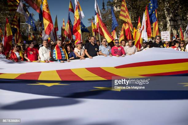 Protesters march during a prounity demonstration on October 29 2017 in Barcelona Spain Thousands of prounity protesters have gathered in Barcelona...