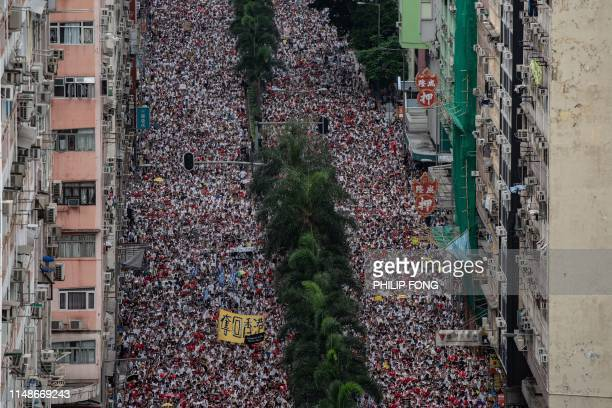 TOPSHOT Protesters march during a rally against a controversial extradition law proposal in Hong Kong on June 9 2019 Huge protest crowds thronged...