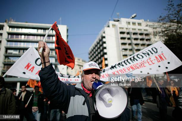 Protesters march during a rally on December 1 2011 in Athens Greece In the wake of previous waves of salary cuts layoffs and tax hikes unions called...