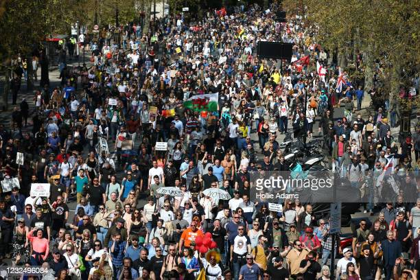 """Protesters march during a """"Unite For Freedom"""" anti-lockdown demonstration held to protest against the use of vaccine passports in the United Kingdom,..."""