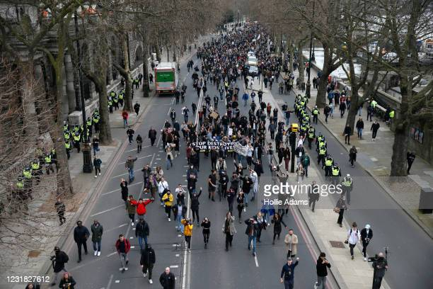 """Protesters march during a """"World Wide Rally For Freedom"""" protest on March 20, 2021 in London, England. """"World Wide Rally For Freedom"""" protests, with..."""