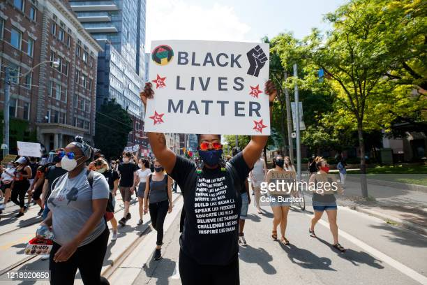 Protesters march during an antiracism march on June 6 2020 in Toronto Canada This is the 12th day of protests since George Floyd died in Minneapolis...