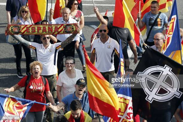 Protesters march during an ultraright wing antiseparatist demonstration for the unity of Spain called by 'Falange Espanola' during the Spanish...