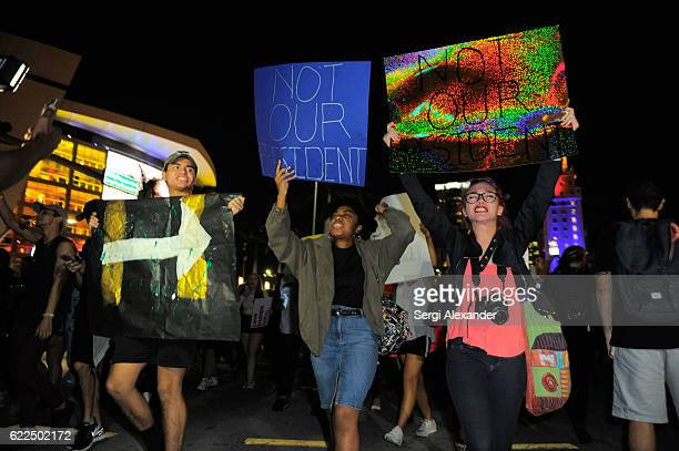 Protesters march during antiTrump protest in downtown Miami on November 11 2016 in Miami Florida