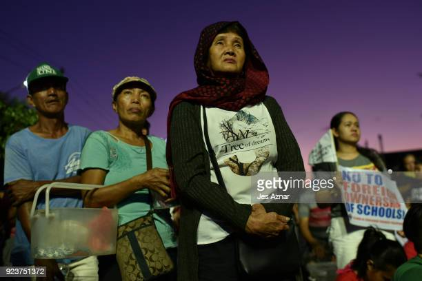 Protesters march during the 32nd annual commemoration of the EDSA People Power uprising on February 24 2018 in Manila Philippines The protester...