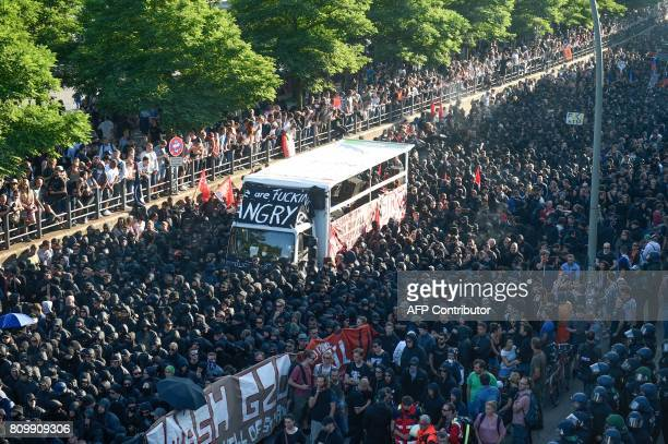TOPSHOT Protesters march during the 'Welcome to Hell' rally against the G20 summit in Hamburg northern Germany on July 6 2017 Leaders of the world's...