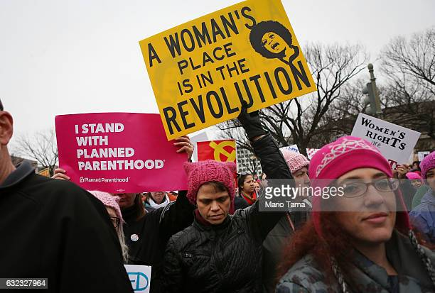 Protesters march during the Women's March on Washington on January 21, 2017 in Washington, DC. Large crowds are attending the anti-Trump rally a day...