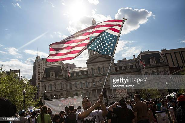 Protesters march from City hall to the Sandtown neighborhood May 2 2015 in Baltimore Maryland Freddie Gray was arrested for possessing a switch blade...