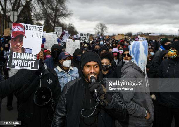 Protesters march from the Brooklyn Center police headquarters to a nearby FBI office on April 13, 2021 in Brooklyn Center, Minnesota. Demonstrations...