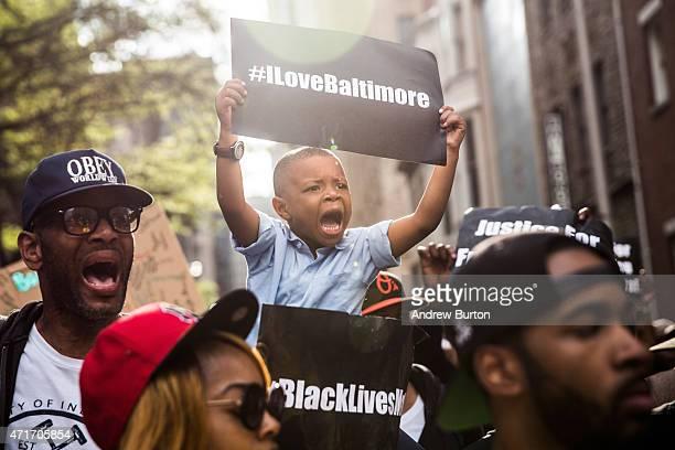 Protesters march from the Sandtown neighborhood to City Hall demanding better police accountability and racial equality following the death of...