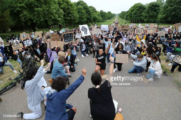 Protesters march from Windsor Castle in solidarity with the Black Lives Matter movement on June 04 2020 in Windsor United Kingdom The death of an...