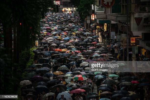 Protesters march holding umbrellas during the demonstration Protesters took to the streets on a rainy Sunday in a prodemocracy demonstration on Hong...