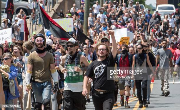 Protesters march in Charlottesville Virginia on August 12 2017 A picturesque Virginia city braced Saturday for a flood of white nationalist...