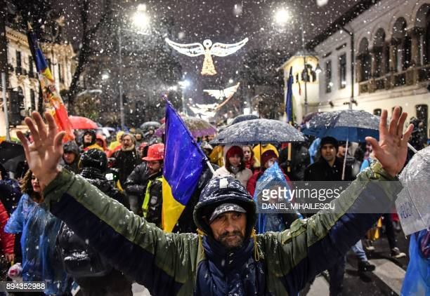 Protesters march in downtown Bucharest during a demonstration in support of the judicial system and against recent law adjustments adopted by the...