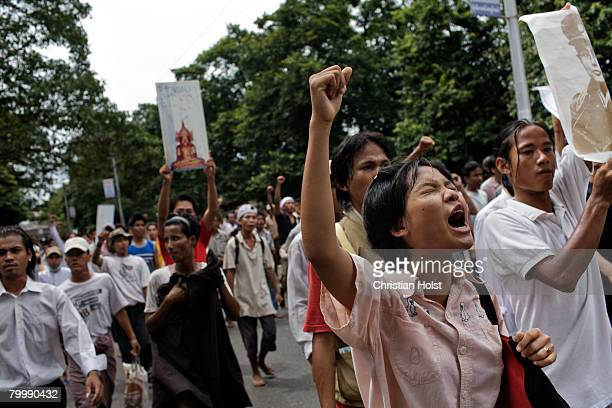 Protesters march in downtown streets on September 27 2007 in Yangon Myanmar The day's demonstrations turned violent when soldiers opening fire A...