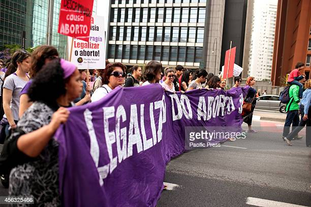 Protesters march in favor of the legalization of abortion in Sao Paulo Abortion is considered a crime in Brazil with exceptions when there are...