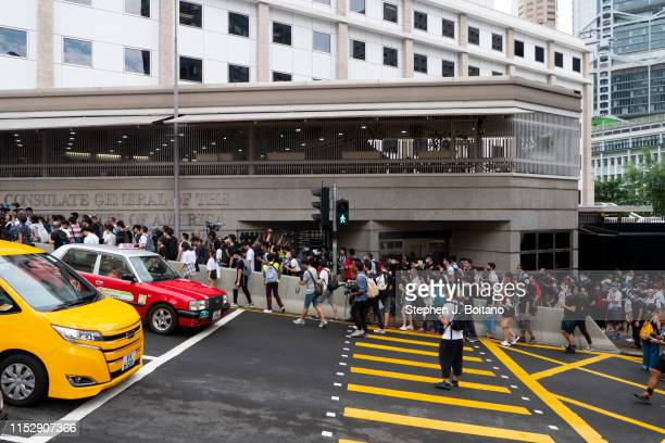 Protesters march in front of the USA consulate before the G20 summit in Osaka Japan. They petitioned 19 embassies and consulates to pressure China on...