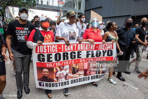 Protesters march in honor of George Floyd on June 2 2020 in Houston Texas Members of George Floyd's family participated in a march that went from...