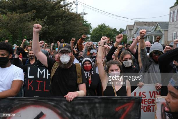 TOPSHOT Protesters march in Louisville Kentucky on September 23 after a judge announced the charges brought by a grand jury against Detective Brett...