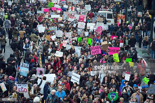 Protesters march in New York during the Womens March on January 21 2017 Hundreds of thousands of people flooded US cities Saturday in a day of...