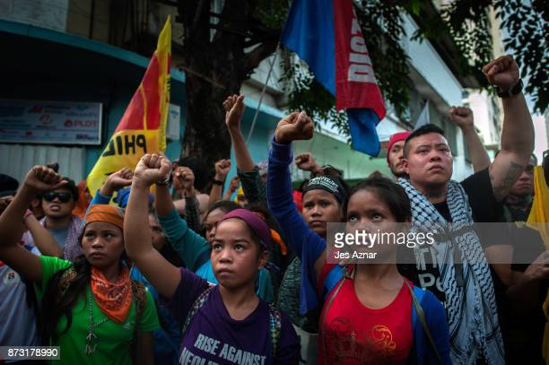 Protesters march in the streets of Manila on the day of US President Trump's arrival on November 12 2017 in Manila Philippines Hundreds of Filipinos...