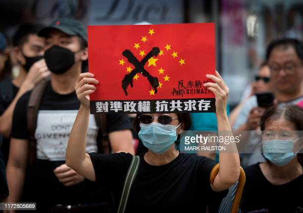 Protesters march in the Wanchai area of Hong Kong on October 1 as the city observes the National Day holiday to mark the 70th anniversary of...