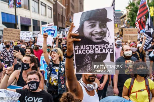 TOPSHOT Protesters march near the Minneapolis 1st Police precinct during a demonstration against police brutality and racism on August 24 2020 in...