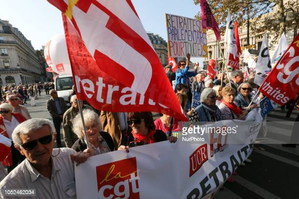 Protesters march near the Opera House during a demonstration called by pensioners' unions on October 18 2018 in Paris to demand pensions' increase...