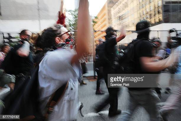 Protesters march near the site of the Republican National Convention in downtown Cleveland on the second day of the convention on July 19 2016 in...