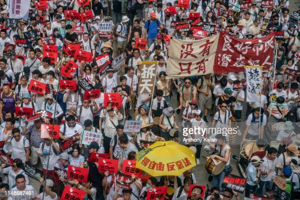 Protesters march on a street during a rally against a controversial extradition law proposal on June 9 2019 in Hong Kong Organizers say more than a...