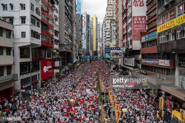 Protesters march on a street during a rally against the extradition law proposal on June 9 2019 in Hong Kong Hundreds of thousands of protesters...