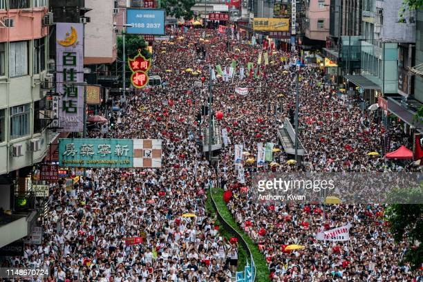 Protesters march on a street during a rally against the extradition law proposal on June 9 2019 in Hong Kong China Hundreds of thousands of...