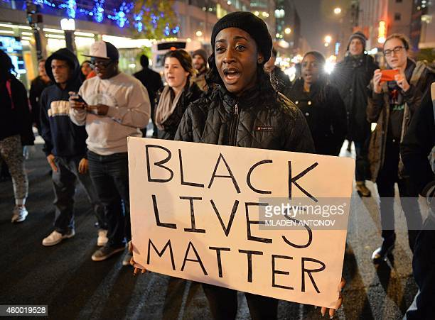 Protesters march on a street in Washington DC on December 05 2014 during the third night of nationwide protests after a grand jury decided not to...